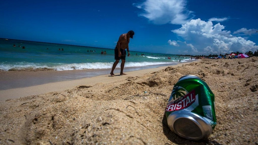An empty beer can lies on the beach near Havana, Cuba, Thursday, Aug. 18, 2016. Litter is a problem virtually everywhere in the world. But the trashing of Cuba's world-class beaches by beachgoers themselves has become so extreme that tourists are complaining and Cubans bemoan it as a symptom of something amiss in a nation that's long cherished cleanliness, order and mutual respect. (AP Photo/Desmond Boylan)