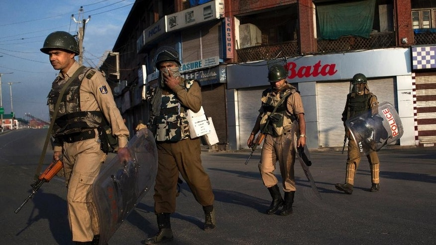 Indian paramilitary soldiers patrol during curfew in Srinagar, Indian-controlled Kashmir, Friday, Aug. 19, 2016. The Himalayan region has been under curfew for almost six weeks as the largest street protests in years erupted after Indian troops killed a top rebel leader, and security was tightened further in the week preceding India's Independence day. (AP Photo/Dar Yasin)