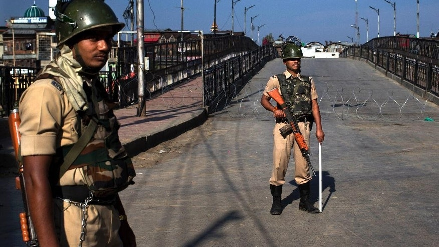 Indian paramilitary soldiers stand guard during curfew in Srinagar, Indian-controlled Kashmir, Friday, Aug. 19, 2016. The Himalayan region has been under curfew for almost six weeks as the largest street protests in years erupted after Indian troops killed a top rebel leader, and security was tightened further in the week preceding India's Independence day. (AP Photo/Dar Yasin)