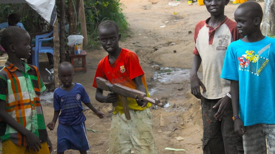In this Monday, July 25, 2016 photo, a group of children at the U.N. protection of Civilians site in Juba, South Sudan, play with a makeshift gun.