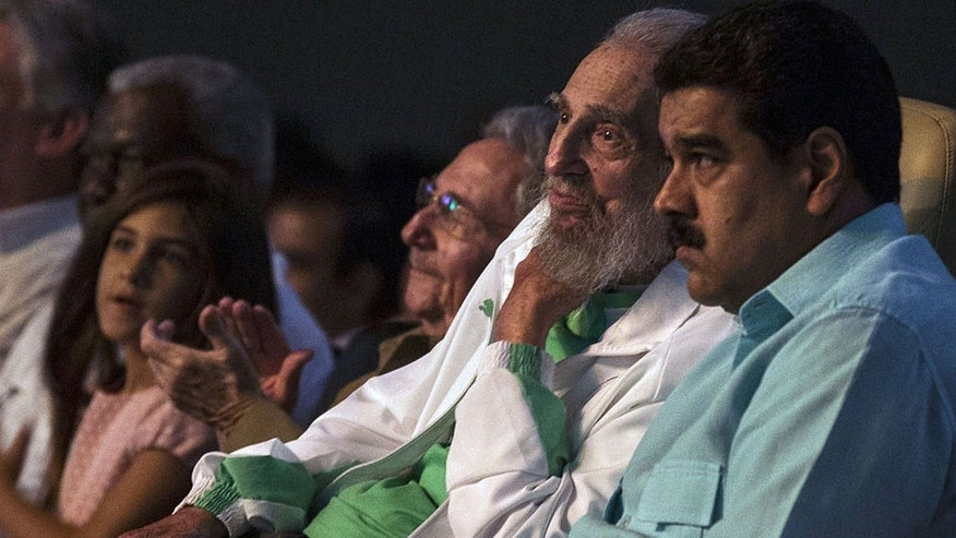 "In this handout picture released by the Cuban website www.cubadebate.cu, former Cuban President Fidel Castro (C), sitting next to Venezuelan President Nicolas Maduro (R), is seen attending the celebration of his 90th birthday at Karl Marx theatre in Havana on August 13, 2016. / AFP / Ismael Francisco / XGTY/RESTRICTED TO EDITORIAL USE-MANDATORY CREDIT ""AFP PHOTO/CUBADEBATE.CU"" NO MARKETING NO ADVERTISING CAMPAIGNS-DISTRIBUTED AS A SERVICE TO CLIENTS-GETTY OUT        (Photo credit should read ISMAEL FRANCISCO/AFP/Getty Images)"