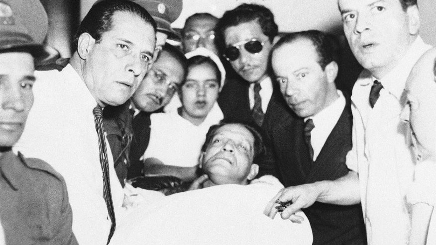 "FILE- In this April 9, 1948, file photo, Jorge Eliecer Gaitan lies dying in the Colombian Capital of Bogoto after being shot. Others are unidentified. The 1948 assassination of populist firebrand Jorge Eliecer Gaitan sparked the political bloodletting known as ""La Violencia,"" or ""The Violence."" The Revolutionary Armed Forces of Colombia are preparing for a peace deal, in Columbia's half-century guerrilla conflict which has roots in the assassination, which they and the government say could be just weeks away. (AP Photo, File)"