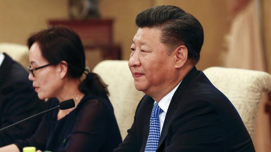 Chinese President Xi Jinping attends in a meeting with Myanmar State Counselor Aung San Suu Kyi at the Diaoyutai State Guesthouse in Beijing, China, Friday, Aug. 19, 2016.(Rolex Dela Pena/Pool Photo via AP)
