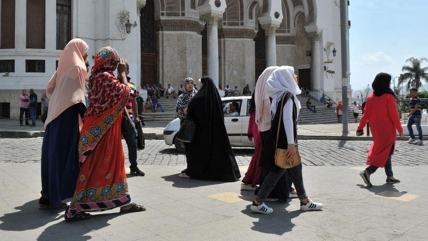 Veiled women walk in central Algiers, Wednesday Aug. 10, 2016.  Mosques are going up, women are covering up and bars, restaurants and shops selling alcoholic beverages are shutting down in a changing Algeria where, slowly but surely, Muslim fundamentalists are gaining ground.(AP Photo/Ouahab Hebbat)