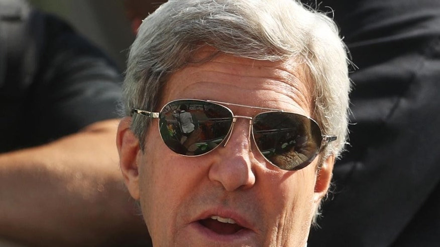 FILE - In this file photo dated Saturday, Aug. 6, 2016, United States Secretary of State John Kerry watches a beach volleyball match at the 2016 Summer Olympics in Rio de Janeiro, Brazil. Kerry will be in Africa on Monday for talks in Kenya and Nigeria on countering terrorism before visiting Saudi Arabia to discuss the conflict in Yemen.(AP Photo/Petr David Josek, FILE)