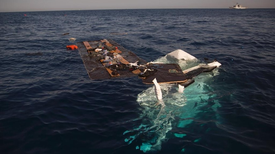 The remains of a dinghy is seen partially sank after a rescue operation by members of Proactiva Open Arms NGO, at the Mediterranean sea, about 17 miles north of Sabratah, Libya, Saturday, Aug. 20, 2016. Migrants seemingly prefer to face the dangers of the journey towards Europe, rather than stay at home.(AP Photo/Emilio Morenatti)