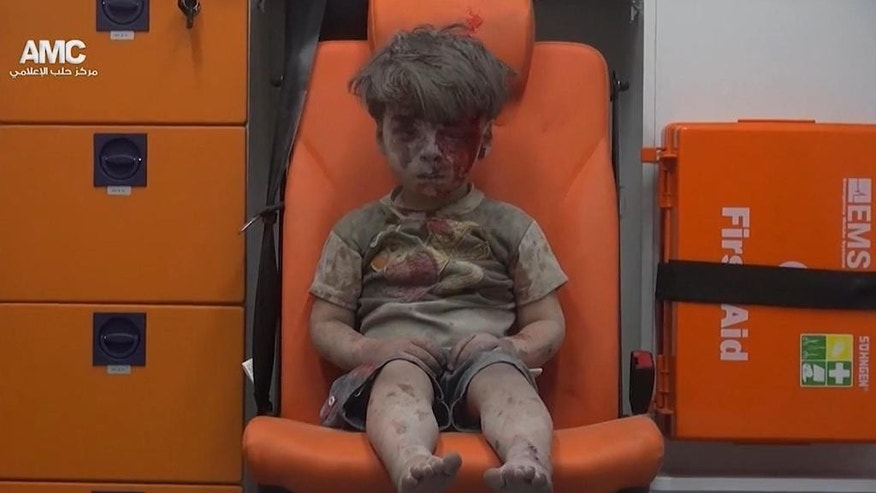 Haunting picture of bloodied Syrian boy (5) sparks outrage around world