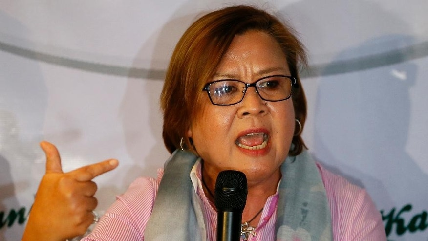 "Former Justice Secretary and now Senator Leila De Lima gestures during a news conference she called to answer allegations about her alleged links to illegal drugs Saturday, Aug. 20, 2016 in suburban Quezon city northeast of Manila, Philippines. De Lima, who was called ""immoral"" by President Rodrigo Duterte, said she is ""willing to be shot in front of the President"" if there is evidence she is involved in illegal drugs. De Lima is scheduled to open a Senate investigation on Monday on the extra-judicial killings related to the ""war on drugs"" by President Duterte. (AP Photo/Bullit Marquez)"