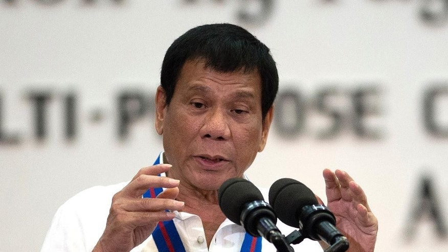 FILE - In this Wednesday, Aug. 17, 2016 file photo, Philippine President Rodrigo Duterte gestures as he talks during the 115th Police Service Anniversary at the Philippine National Police headquarters in Manila. The Philippines' brash-talking president has threatened to withdraw his country from the United Nations in his latest outburst against critics of his anti-drugs campaign that has left hundreds of suspects dead. Duterte ridiculed the U.N. as inutile, and lashed at U.S. police killings of black men. (Noel Celis/Pool Photo via AP, File)