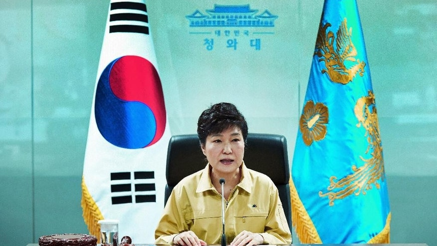 South Korean President Park Geun-hye speaks during a session of the National Security Council at the presidential house in Seoul, South Korea, Monday, Aug. 22, 2016. South Korea and the United States began annual military drills Monday despite North Korea's threat of nuclear strikes in response to the exercises that it calls an invasion rehearsal. (Baek Seung-ryul/Yonhap via AP)
