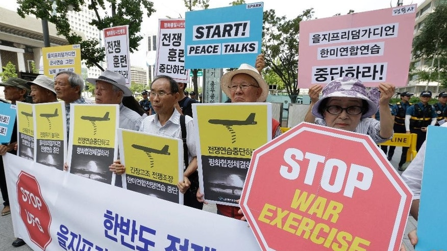 "South Korean protesters stage a rally demanding to stop the joint military exercises, Ulchi Freedom Guardian, or UFG, between the U.S. and South Korea near U.S. Embassy in Seoul, South Korea, Monday, Aug. 22, 2016. South Korea and the United States began annual military drills Monday despite North Korea's threat of nuclear strikes in response to the exercises that it calls an invasion rehearsal. Signs held by the protesters read: ""Stop Ulchi Freedom Guardian exercise and war exercise."" (AP Photo/Ahn Young-joon)"