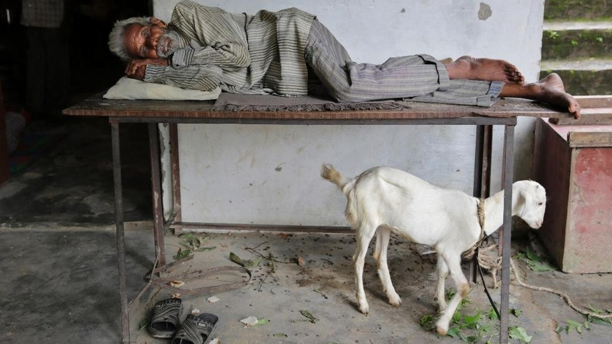 A man takes a rest at a temporary shelter after several areas were flooded in Allahabad, India, Monday, Aug. 22, 2016. Heavy rainfall in the upper reaches of the country has caused rivers to overflow endangering lives and properties of people along the river Ganges as also in other parts of the country. (AP Photo/Rajesh Kumar Singh)