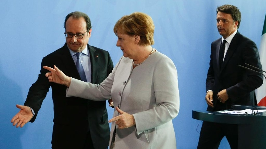 FILE - In this Monday, June 27, 2016 file photo, German Chancellor Angela Merkel, center, the Prime Minister of Italy Matteo Renzi, right, and the President of France Francois Hollande, left, leave a news conference during a meeting at the chancellery in Berlin. Italian Premier Matteo Renzi has invited his German and French counterparts to pay their respects at the tomb of one of the founding fathers of European unity in a symbolic bid to relaunch the bloc after Britain's clamorous decision to leave the EU. The location for Monday's summit carries particular resonance as Europe confronts Islamic extremist violence, economic stagnation and continued anxiety over the implications of the Brexit vote.  (AP Photo/Markus Schreiber, File)