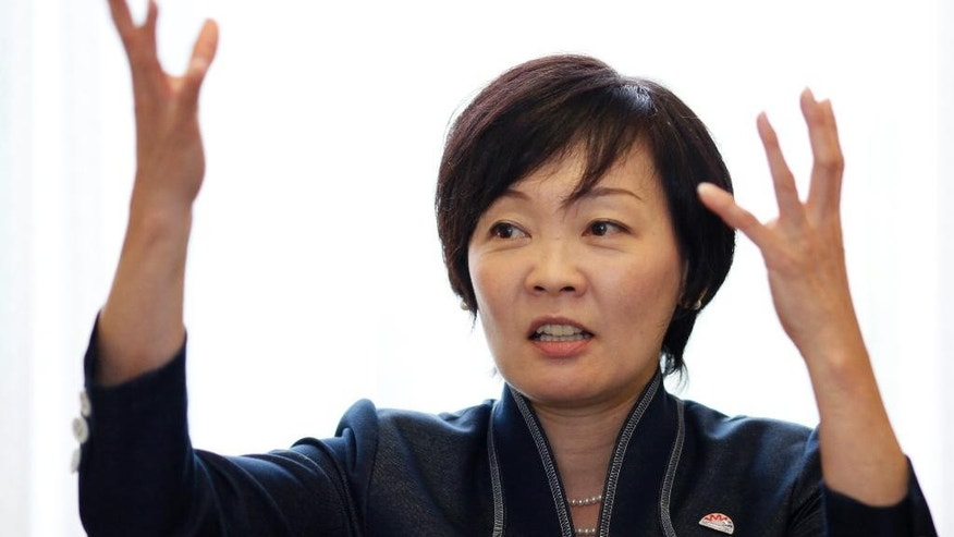 "FILE - In this Sept. 4, 2014 file photo, Akie Abe, wife of Japanese Prime Minister Shinzo Abe, speaks during an interview with The Associated Press at the prime minister's official residence in Tokyo. Japan's first lady has visited Pearl Harbor for the first time to pay tribute to the victims of the Japanese attack 75 years ago. Abe said in her Facebook entry Monday, Aug. 22, 2016 that she laid flowers and prayed at the USS Arizona Memorial. ""I offered flowers and a prayer,"" she wrote in a short message. (AP Photo/Eugene Hoshiko, File)"