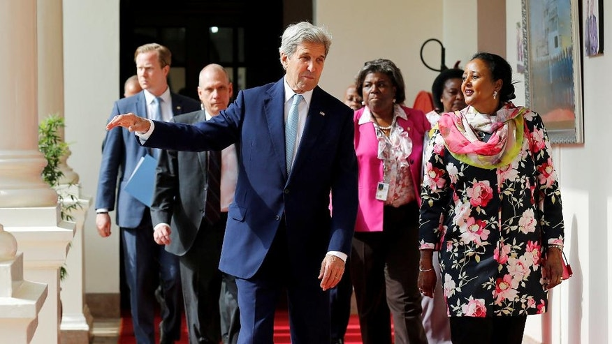 U.S. Secretary of State John Kerry, front left, talks to Kenya's Foreign Affairs Cabinet Secretary Amina Mohamed, right,  as he arrives at the State House for bilateral talks in Kenya's capital Nairobi, Monday Aug. 22, 2016. Kerry arrived Sunday in Kenya to hold talks with leaders of the East African nation that are expected to focus on regional security and extremism.(Thomas Mukoya/Pool via AP)