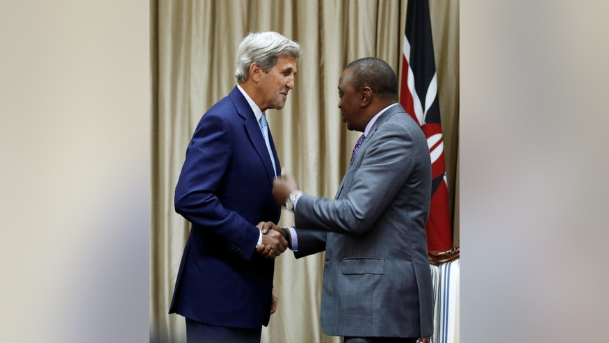 U.S. Secretary of State John Kerry, left, talks to Kenya's President Uhuru Kenyatta when before their bilateral talks at the State House in Kenya's capital Nairobi, Monday Aug. 22, 2016. Kerry arrived Sunday in Kenya to hold talks with leaders of the East African nation that are expected to focus on regional security and extremism.(Thomas Mukoya/Pool via AP)