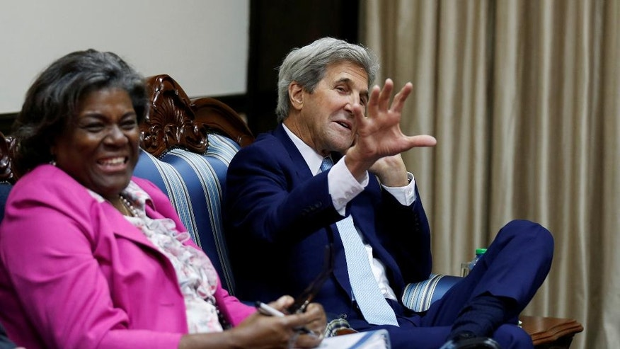 U.S. Secretary of State John Kerry, right, sits with U.S. Assistant Secretary of State for Africa Linda Thomas-Greenfield, at the start of bilateral talks with Kenya's President Uhuru Kenyatta, at the State House in Kenya's capital Nairobi, Monday Aug. 22, 2016. Kerry arrived Sunday in Kenya to hold talks with leaders of the East African nation that are expected to focus on regional security and extremism.(Thomas Mukoya/Pool via AP)