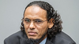 Ahmad Al Faqi Al Mahdi appears at the International Criminal Court in The Hague, Netherlands, Monday, Aug. 22, 2016, at the start of his trial on charges of involvement in the destruction of historic mausoleums in the Malian desert city of Timbuktu. Prosecutors allege that Al Mahdi was a member of an al Qaida-linked occupying force that destroyed most of Timbuktu's World Heritage-listed mausoleums in 2012. (AP Photo/Patrick Post, Pool)