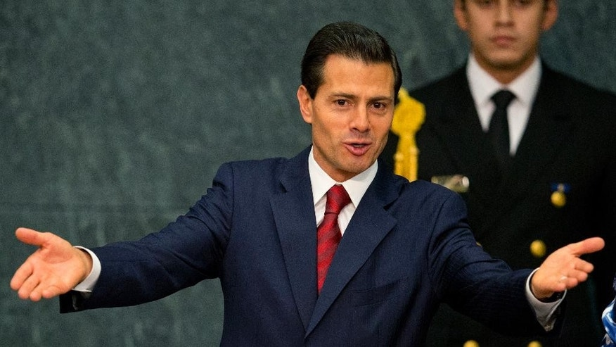FILE - In this May 24, 2016 file photo, Mexican President Enrique Pena Nieto opens the 36th session of the Economic Commission for Latin America and the Caribbean, at Los Pinos presidential residence in Mexico City. A Mexican news outlet published Sunday, Aug. 21, 2016, a report alleging that Pena Nieto's thesis for his law degree was heavily plagiarized. Aristegui Noticias says 29 percent of the thesis was material lifted from other works. (AP Photo/Rebecca Blackwell, File)