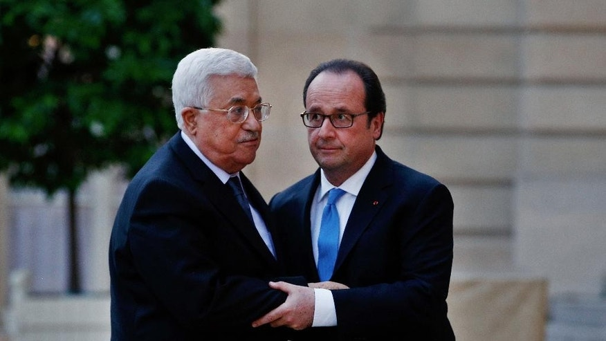 FILE -- In this July 21, 2016 file photo, France's President Francois Hollande, right, greets Palestinian President Mahmoud Abbas, prior to a meeting at the Elysee Palace, in Paris. A new poll of Israelis and Palestinians released on Monday, Aug. 22, 2016, found that a slim majority on both sides still favor a peace settlement establishing a Palestinian state alongside Israel, despite years of conflict and deadlock in negotiations. The results of the joint poll may provide some small signs of encouragement when peace prospects appear bleak. (AP Photo/Thibault Camus, File)