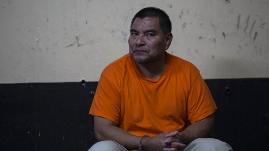 Santos Lopez Alonzo sits in a courtroom as he waits for his first hearing in Guatemala City, Wednesday, Aug. 10, 2016. Lopez Alonzo, former Guatemalan soldier suspected of helping carry out a massacre of more than 160 people in 1982 during the country's civil war was deported from the United States on Wednesday after a court refused his plea to stay because he fears for his life. (AP Photo/Luis Soto)