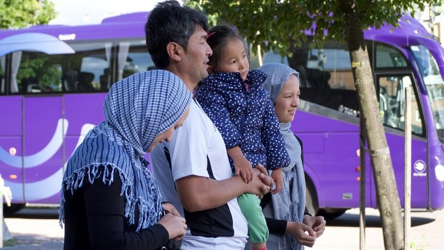 In this Aug. 14, 2016 photo, Mahdi Azizi's parents and sisters watch as he leaves to return to return to the centre for unaccompanied minors in Vasteras, Sweden. Whilst Mahdi has been granted asylum, his parents have been turned down and asked to leave the country.Love, not war, made the Azizi family flee Iran during last summer's chaotic mass migration to Europe. Luck reunited them a year after a dark night in a Turkish forest separated 14-year-old Mahdi Azizi from his parents and sisters. (AP Photo/David Keyton)