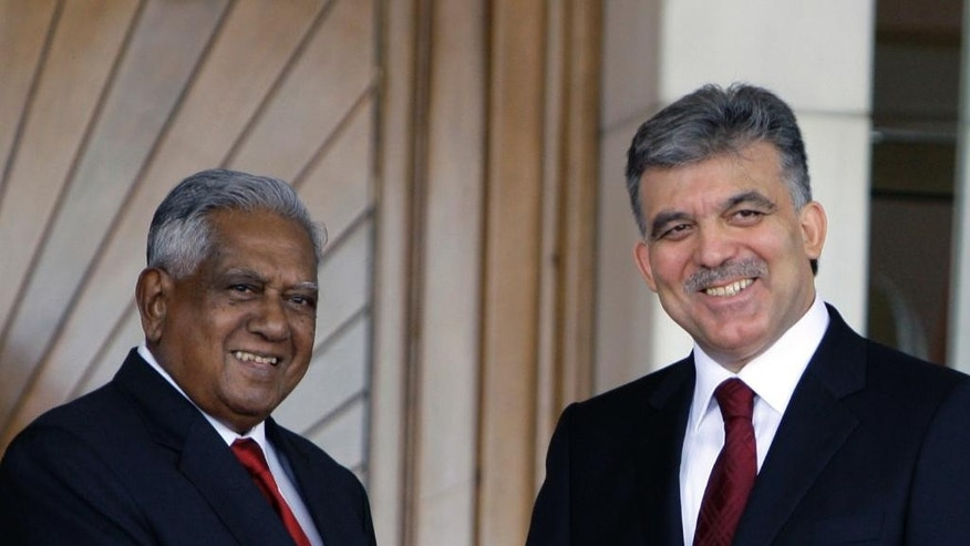 FILE - In this Wednesday, June. 10, 2009 file photo, President of the Republic of Singapore  S.R. Nathan, left, and his Turkish counterpart Abdullah Gul shake hands as they pose for cameras during welcoming ceremony at the Cankaya Palace in Ankara, Turkey. Sellapan Ramanathan, Singapore's sixth and longest-serving president, died Monday, Aug. 22, 2016 at age 92, the government announced. Widely known as S.R. Nathan, he was hospitalized in critical condition after suffering a stroke on July 31. It was his second stroke in less than two years. (AP Photo/Burhan Ozbilici, File)