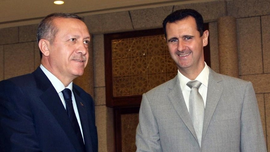 Syrian President Bashar Assad, right, shaking hands with Turkey's then-Prime Minister Recep Tayyip Erdogan in 2010.