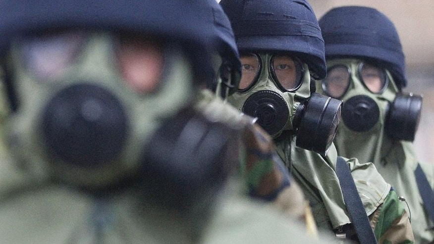 South Korean police officers wearing gas masks conduct an anti-terror drill as part of Ulchi Freedom Guardian exercise, at Yoido Subway Station in Seoul, South Korea, Tuesday. South Korea and the United States began annual military drills Monday despite North Korea's threat of nuclear strikes in response to the exercises that it calls an invasion rehearsal.
