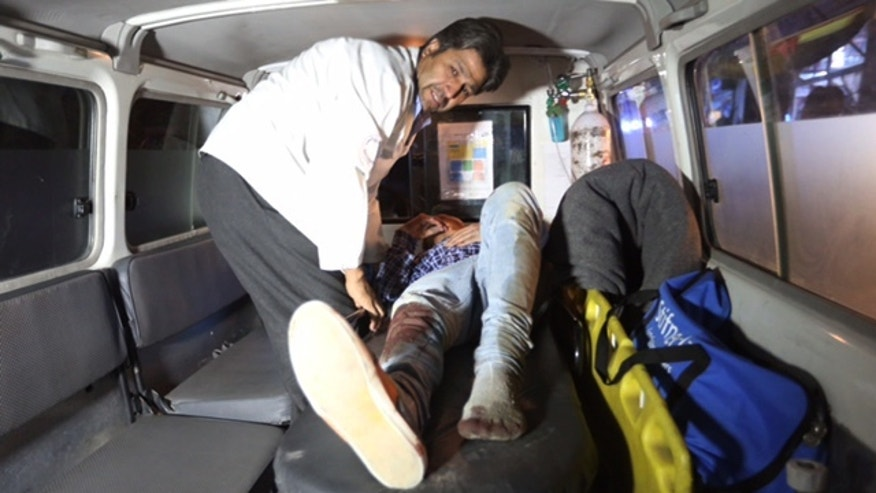"A wounded person is treated in an ambulance after a complex Taliban attack on the campus of the American University in the Afghan capital Kabul on Wednesday, Aug. 24, 2016. ""We are trying to assess the situation,"" President Mark English told The Associated Press. (AP Photo/Rahmat Gul)"