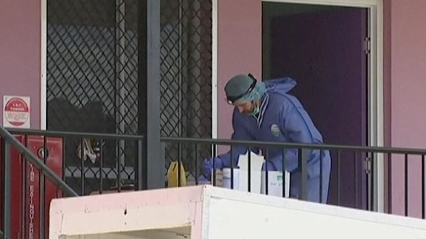 "In this image made from video  from the Australian Broadcasting Corporation, emergency personnel work the scene on Wednesday, Aug. 24, 2016, after an attack took place on Tuesday, at a hostel in the town of Home Hill in northern Queensland, Australia. Police say a French man shouting the Arabic phrase ""Allahu akbar"" stabbed a British woman to death and wounded two men in the attack (Australian Broadcasting Corporation via AP Photo)"