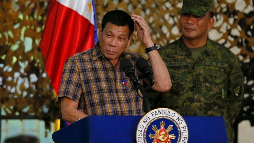 Philippine President Rodrigo Duterte addresses the troops during his visit to the Philippine Army's Camp Mateo Capinpin at Tanay township, Rizal province east of Manila, Philippines Wednesday, Aug. 24, 2016. President Duterte's threat to withdraw the Philippines from the United Nations, later cushioned by his foreign secretary, is the latest flamboyantly irreverent utterance from a politician who has disparaged the pope, human rights advocates, the United States and other countries who controvert his worldview.(AP Photo/Bullit Marquez)