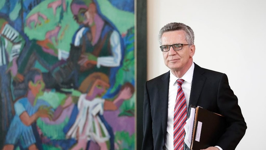 German Interior Minister Thomas de Maiziere arrives for the weekly cabinet meeting at the Chancellery in Berlin, Germany, Wednesday, Aug. 24, 2016. (AP Photo/Michael Sohn)