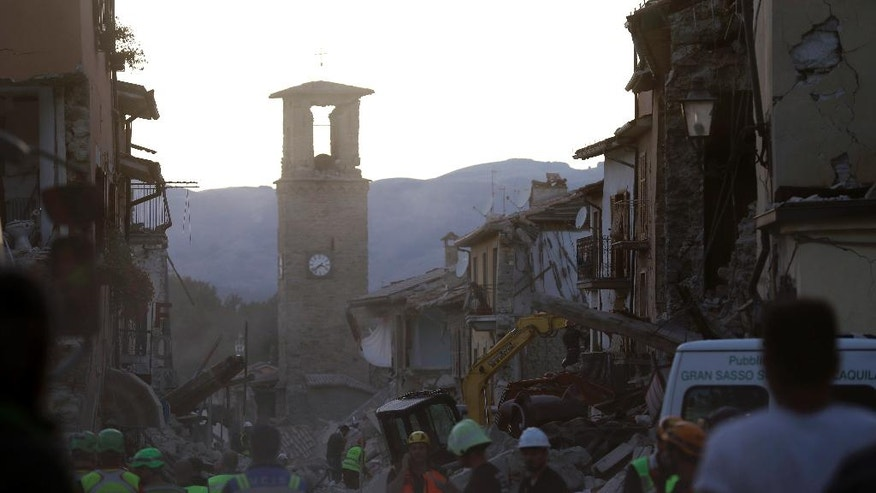 Rescuers at work following an earthquake in the village of Amatrice, central Italy, Wednesday, Aug. 24, 2016. The magnitude 6 quake struck at 3:36 a.m. (0136 GMT) and was felt across a broad swath of central Italy, including Rome where residents of the capital felt a long swaying followed by aftershocks.  (AP Photo/Alessandra Tarantino)