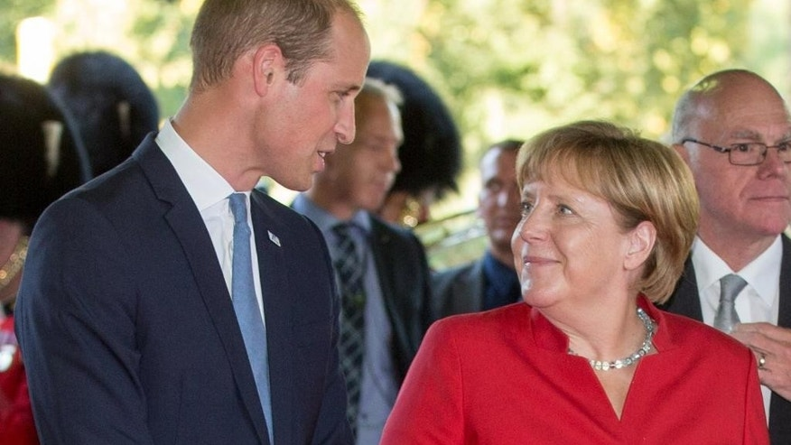 Britain's Prince  William, Duke of Cambridge, is greeted by German Chancellor Angela Merkel   during celebrations of the 70th anniversary of the foundation of the German state of North Rhine-Westphalia in Duesseldorf, Germany, Tuesday Aug. 23, 2016. (Maja Hitij/dpa via AP)