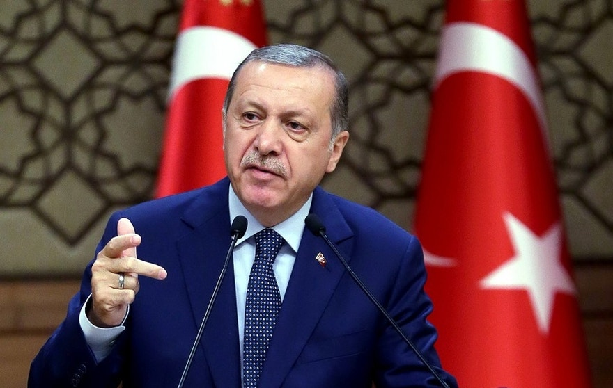 Turkey's President Recep Tayyip Erdogan speeches to the heads of chambers of commerce in Ankara, Turkey, on Thursday, Aug. 4, 2016. Erdogan vowed to go after businesses linked to a US-based Muslim cleric he accuses of having been behind Turkey's failed July 15 coup. The Turkish government characterizes the movement of Fethullah Gulen, who lives in self-imposed exile in Pennsylvania, as a terrorist organization. (Kayhan Ozer/Presidential Press Service, Pool Photo via AP)
