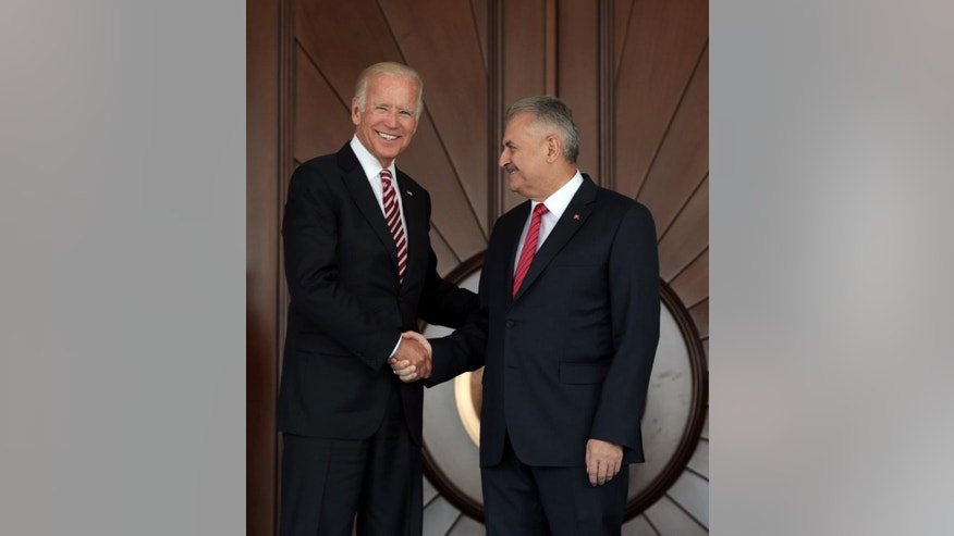 U.S Vice President Joe Biden, left, shakes hands with Turkish Prime Minister Binali Yildirim as he arrives for a meeting in Ankara, Turkey, Wednesday, Aug. 24, 2016. Biden has arrived in Ankara for talks with Turkish leaders as Turkey launched a military operation to clear a Syrian border town of Islamic State militants. The visit comes at a difficult time for ties between the two NATO allies.(AP Photo/Burhan Ozbilici)
