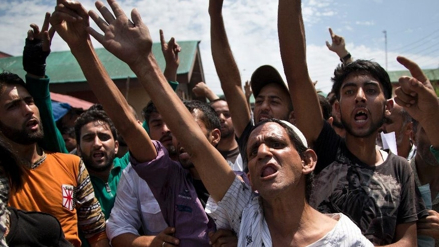 Kashmiri Muslims shout pro freedom slogans as they protest against the killing of civilian Amir Mir, outside a hospital in Srinagar, Indian controlled Kashmir, Wednesday, Aug. 24, 2016. Indian government forces fired shotguns and tear gas in India's portion of Kashmir on Wednesday to break up new protests demanding an end to Indian rule in the disputed Himalayan region, killing a young man and wounding dozens of other people. (AP Photo/Dar Yasin)
