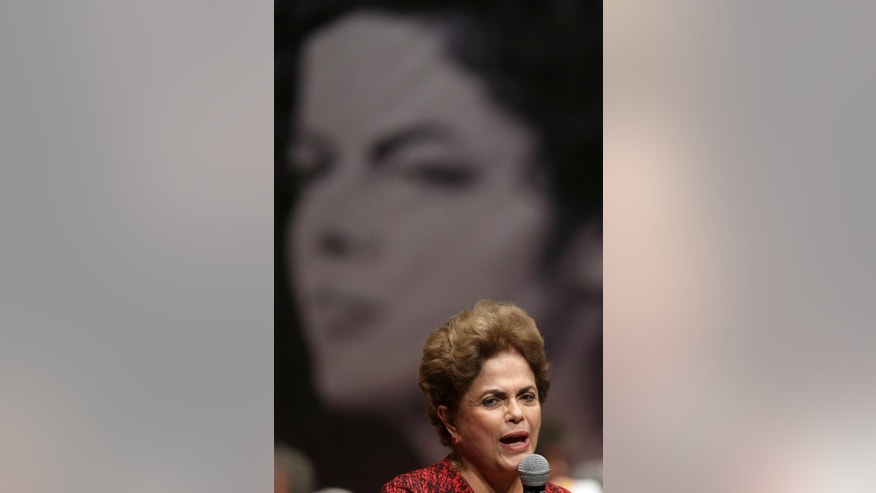 Brazil's suspended President Dilma Rousseff speaks during a rally in support of democracy and against the coup, in Brasilia, Brazil, Wednesday, Aug. 24, 2016. Brazil's Senate braces for a final showdown in a trial that could overthrow President Dilma Rousseff after months of lengthy proceedings in Congress. She is accused of breaking fiscal laws, in managing the federal budget as her government ran out of resources. (AP Photo/Eraldo Peres)