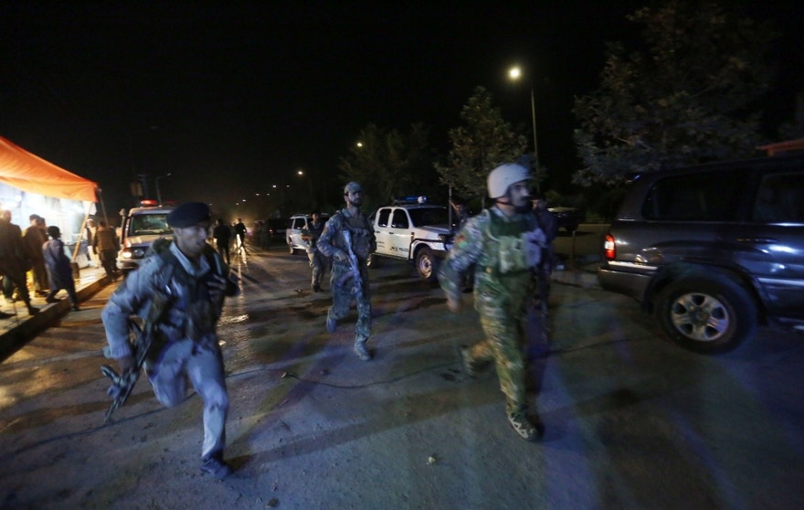 "Afghan security forces rush to respond to a complex Taliban attack on the campus of the American University in the Afghan capital Kabul on Wednesday, Aug. 24, 2016. ""We are trying to assess the situation,"" President Mark English told The Associated Press. (AP Photo/Rahmat Gul)"