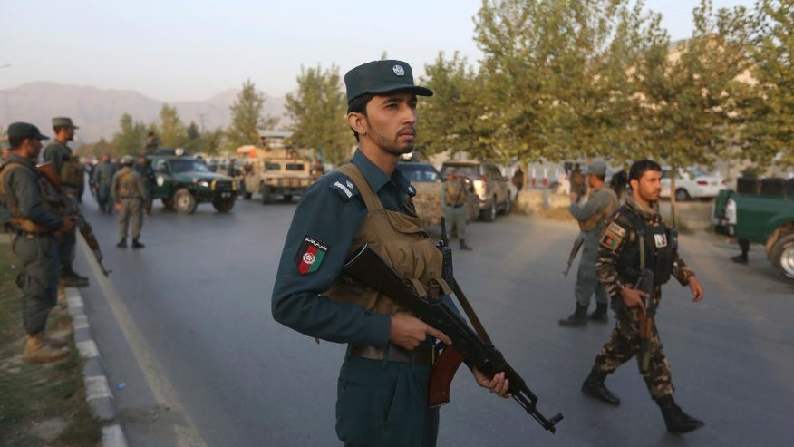 Afghan security forces stand guard after an attack on the American University of Afghanistan in Kabul, Afghanistan, Thursday, Aug. 25, 2016. The attack has ended, a senior police officer said Thursday, after several people were killed. Kabul police Chief Abdul Rahman Rahimi said the dead included one guard, and that about 700 students had been rescued. (AP Photo/Rahmat Gul)