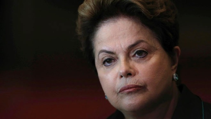 FILE - In this Oct. 6, 2014 file photo, Brazil's President Dilma Rousseff listens to a question during a re-election campaign news conference at the Alvorada Palace in Brasilia, Brazil. Just days after the Rio Olympics ended, Brazilian senators are now gearing up for a final decision on whether to permanently remove President Dilma Rousseff from office. The months-long leadership fight has brought to the surface deep polarization in Latin America's most populous nation, fueled by anger over endemic corruption and angst about an emerging economy that has gone from darling to depression amid its worst financial crisis in decades. (AP Photo/Eraldo Peres, File)
