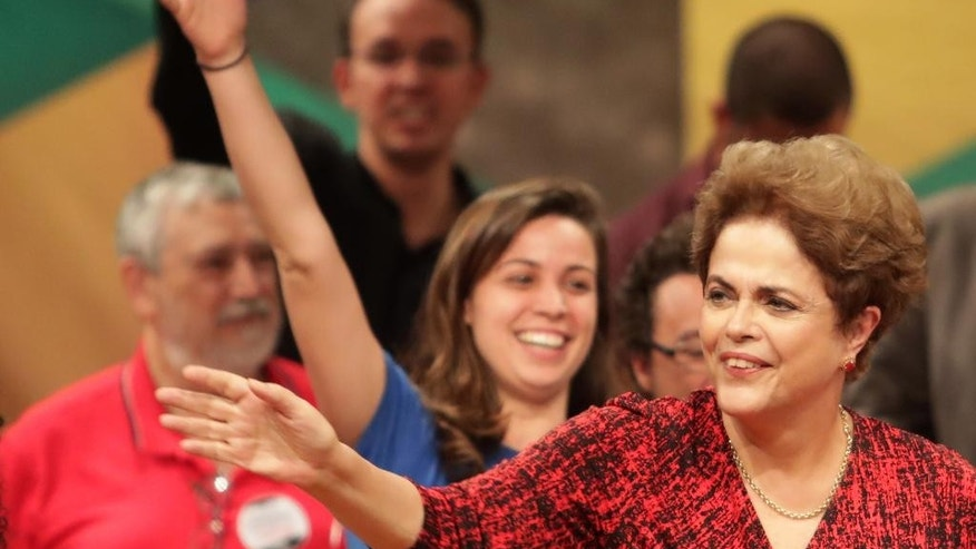 Brazil's suspended President Dilma Rousseff arrives at a rally in Brasilia, Brazil, Wednesday, Aug. 24, 2016. Brazil's Senate braces for a final showdown in a trial that could overthrow President Rousseff after months of lengthy proceedings in Congress. She is accused of breaking fiscal laws, in managing the federal budget as her government ran out of resources. (AP Photo/Eraldo Peres)