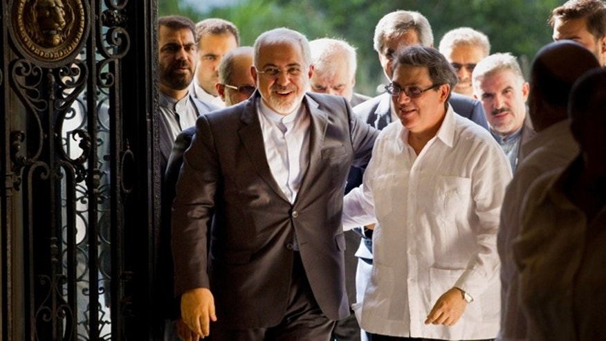 Iranian Foreign Minister Mohammad Javad Zarif, left, is welcomed by Cuban Foreign Minister Bruno Rodriguez, in Havana, Cuba, Monday, Aug. 22, 2016. Irans foreign minister begun a Latin American tour in Cuba, declaring Iran and Cuba united by their histories of resisting what he called U.S. atrocities. Zarif also plans to visit Nicaragua, Ecuador, Chile, Bolivia and Venezuela. (AP Photo/Ramon Espinosa)