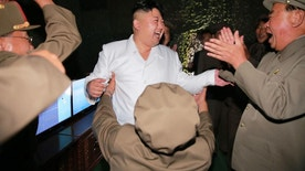 """In this undated photo distributed on Thursday, Aug. 25, 2016, by the North Korean government, North Korean leader Kim Jong Un, center, visits the site of a submarine-launched missile test at an undisclosed location in North Korea. Independent journalists were not given access to cover the event depicted in this image distributed by the Korean Central News Agency via Korea News Service. Kim said Thursday, Aug. 25, 2016, that his country had achieved the """"success of all successes"""" in launching a missile from a submarine, saying it effectively gave the country a fully equipped nuclear attack capability and put the U.S. mainland within striking distance. Associated Press Photo Editors have detected evidence of photo manipulation on Kim Jong Un's face in this image. (Korean Central News Agency/Korea News Service via AP)"""