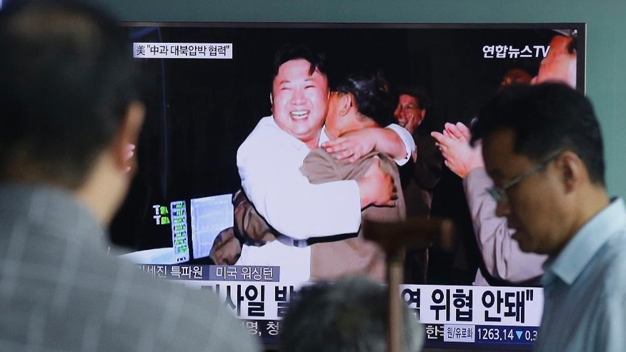 "People watch a TV news program showing an image published Thursday in North Korea's Rodong Sinmun newspaper of North Korean leader Kim Jong-un, at the Seoul Railway station in Seoul, South Korea, Thursday, Aug. 25, 2016. North Korean leader Kim said Thursday that his country had achieved the ""success of all successes"" in launching a missile from a submarine, saying it effectively gave the country a fully equipped nuclear attack capability and put the U.S. mainland within striking distance. (AP Photo/Ahn Young-joon)."