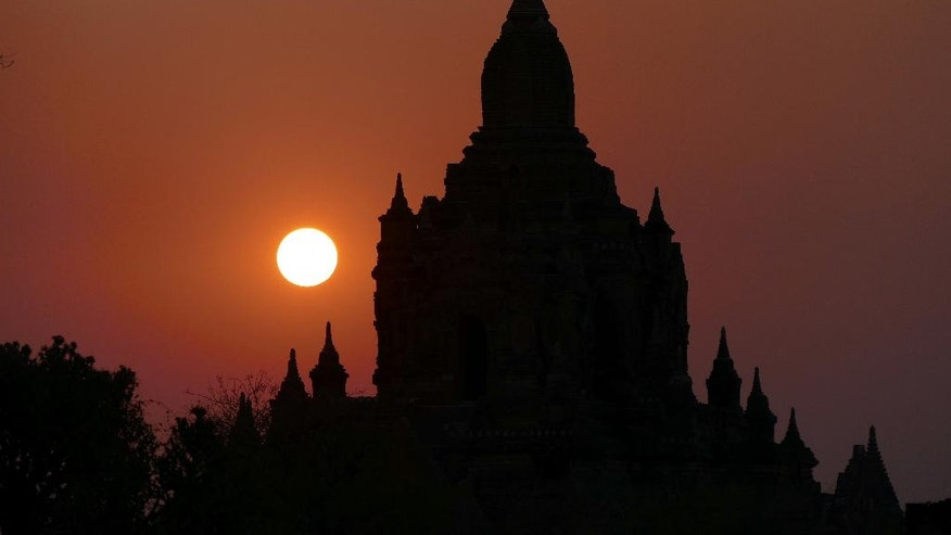 FILE - In this Tuesday Feb. 24, 2015, file photo, the sun sets behind old temples in Bagan, Myanmar.  A powerful earthquake measuring magnitude 6.8 shook central Myanmar on Wednesday, Aug. 24, 2016, damaging scores of ancient Buddhist pagodas in the former capital of Bagan, a major tourist attraction, officials said. (AP Photo/Khin Maung Win, File)