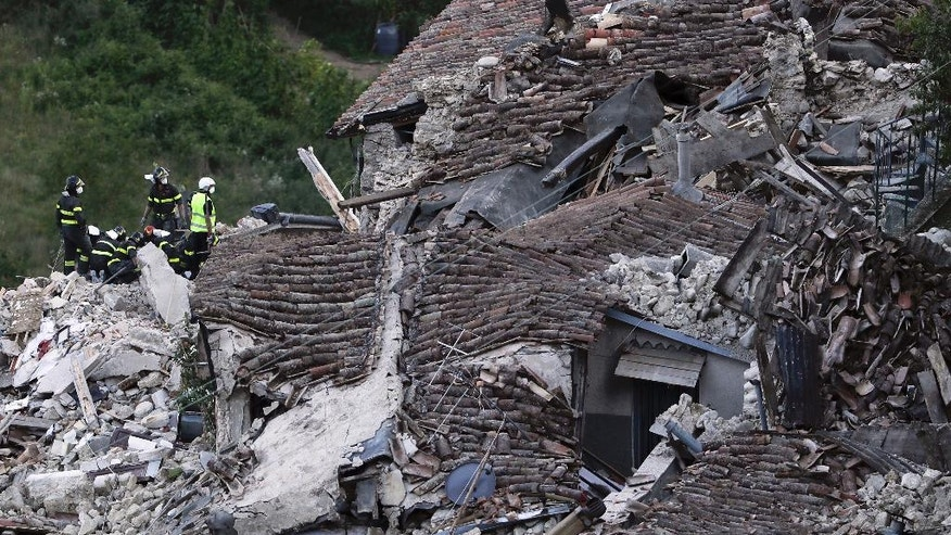Rescuers search amid rubble of collapsed houses following an earthquake in Pescara Del Tronto, Italy, Wednesday, Aug. 24, 2016. The magnitude 6 quake struck at 3:36 a.m. (0136 GMT) and was felt across a broad swath of central Italy, including Rome where residents of the capital felt a long swaying followed by aftershocks. (AP Photo/Gregorio Borgia)