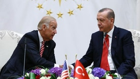 U. S. Vice President Joe Biden, left, and Turkish President Recep Tayyip Erdogan shake hands after a meeting in Ankara, Turkey, Wednesday, Aug. 24, 2016. Biden called on Turkish authorities on Wednesday to be patient with the U.S. legal system as Turkey seeks the return of the cleric accused of masterminding last month's failed military coup, Fethullah Gulen, saying the extradition process would take time. (Kayhan Ozer, Presidential Press Service Pool via AP)