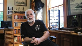 """In this Aug. 23, 2016 photo, Paul Watson, founder of the Sea Shepherd Conservation Society, made famous by the television show """"Whale Wars"""" discusses a recent legal battle over anti-whaling activities, at his home office in Woodstock, Vt. Japan's Institute of Cetacean Research and a whale ship operator announced this week they'd reached an agreement with Sea Shepherd Conservation Society over those anti-whaling activities. Watson said the settlement only prevents the group's U.S. organization from interfering with Japanese whalers in the Southern Ocean. (AP Photo/Lisa Rathke)"""